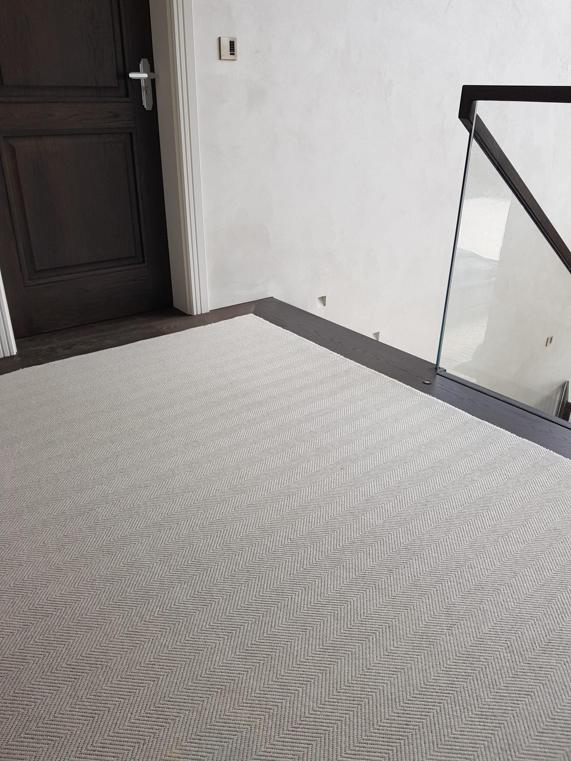 Wool Herringbone Chartwell inlaid carpet with wood floor border