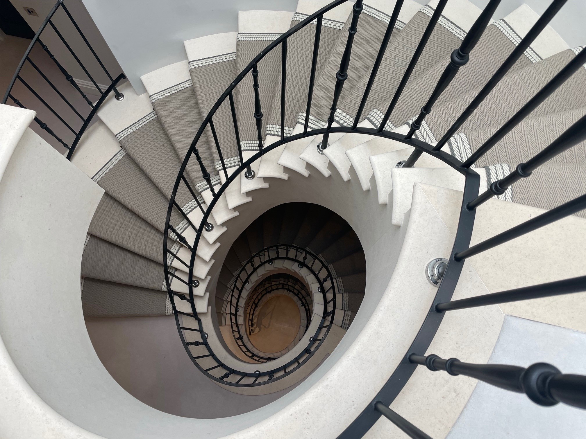 Spiral Staircase with flatweave runner